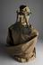 Copy of a strait jacket, c. 1930. Photographed displayed on a straw mannequin. 3/4 view. Grey Background.