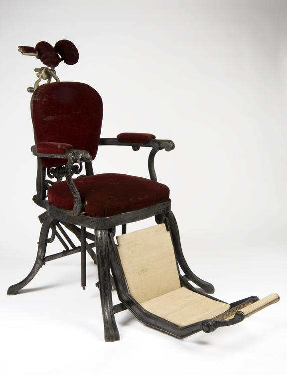 Dental chair, English, 1880-1910.       Full 3/4 view, white background.