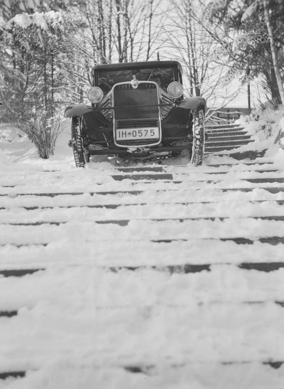 Stoewer car driving down snow covered steps