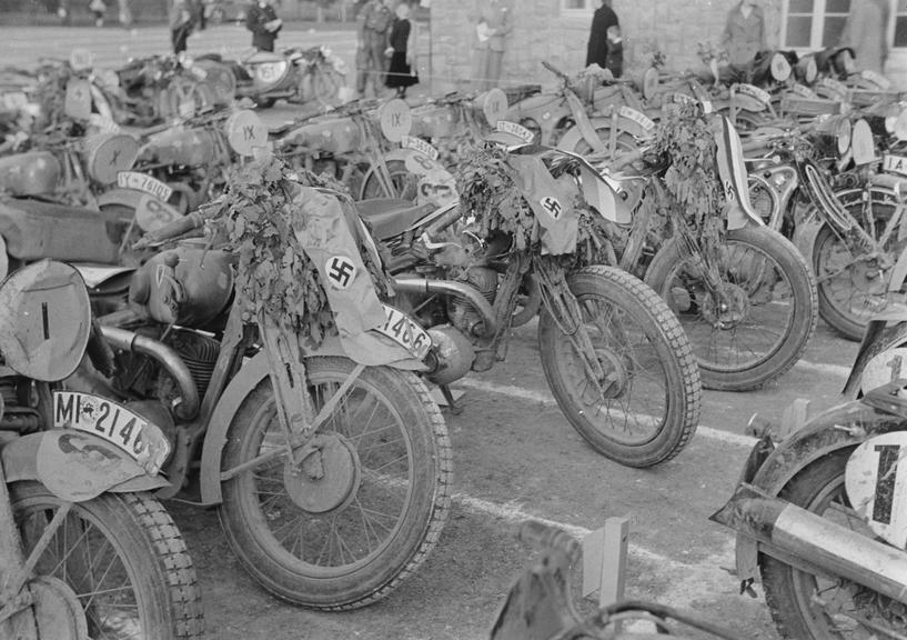 Rows of stationary motorcycles at a race track