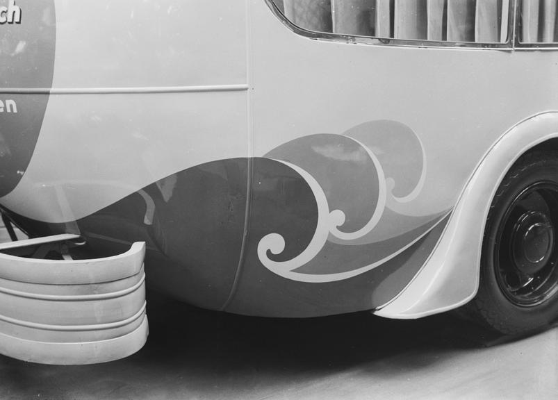 View of the rear of a vehicle, decorated with waves