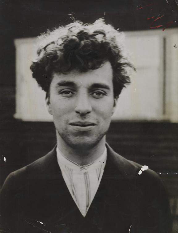 Portrait of Charlie Chaplin as a young man in Hollywood       A photographic portrait of Charlie Chaplin as a young man, Hollywood, taken around 1916 by an unknown photographer