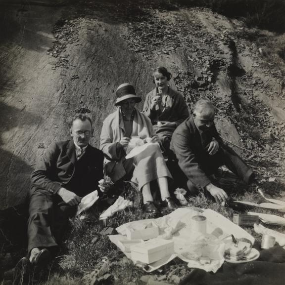 Group picnicking       A snapshot photograph of a group picnicking by an unknown photographer, perhaps in the 1920s
