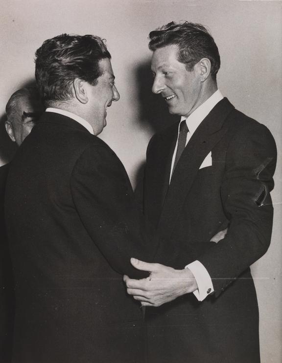 Sid Field greeting Danny Kaye       A photograph of entertainer Sid Field (1904-1950) greeting the American actor and comedian Danny Kaye (1913-1987) at a