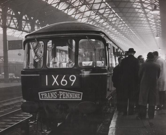 Trans-Pennine train leaves Manchester station       A photograph of a Trans-Pennine train leaving Manchester station, taken in December 1960 by White for the Daily Herald