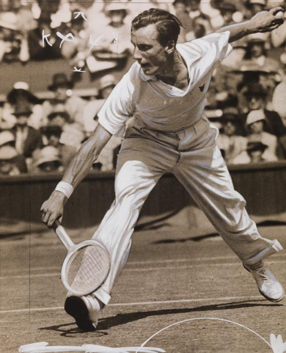 Fred Perry during tennis match at Wimbledon       A photograph of Fred Perry during a tennis match in Wimbledon