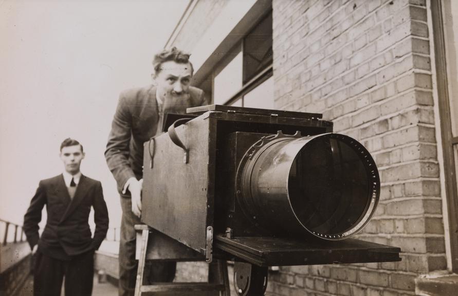 'Fellowmen at Play' - man with long focus camera