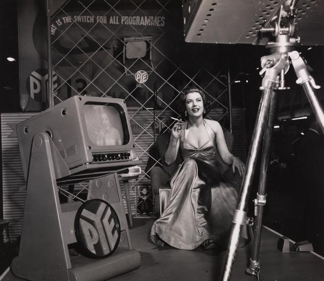Avis Scott poses in front of a 3-D television camera       A photograph of Avis Scott (1927-2010) in front of a 3-D camera, taken in August 1954 by F Greaves for the Daily Herald