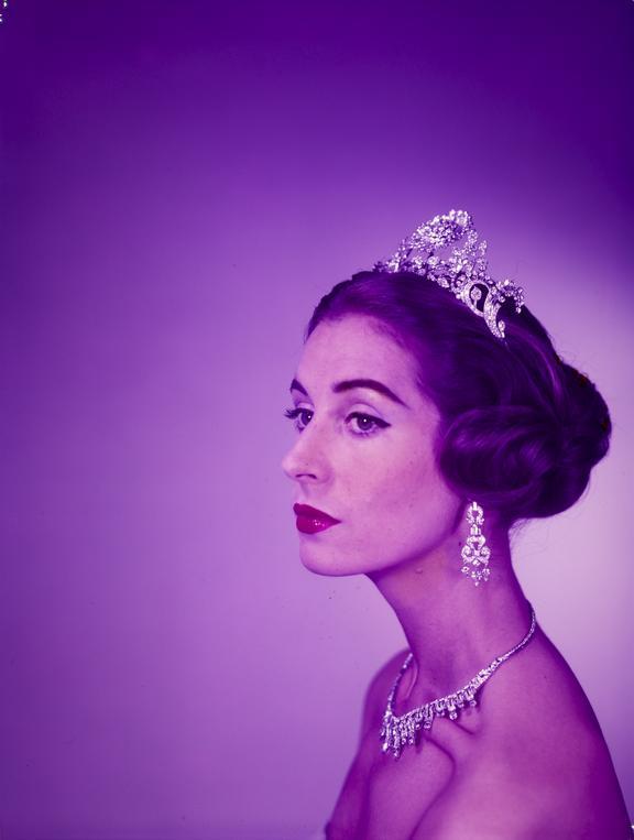 Regal woman modelling tiara, earrings & necklace