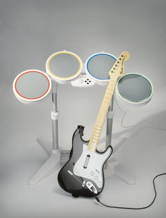 Harmonix Rock Band prototype material       A guitar and drumset from the Rock Band videogame