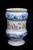 C17 North Italian blue and white albarello vase from Liguria, used for balm of wisdom. Black background.