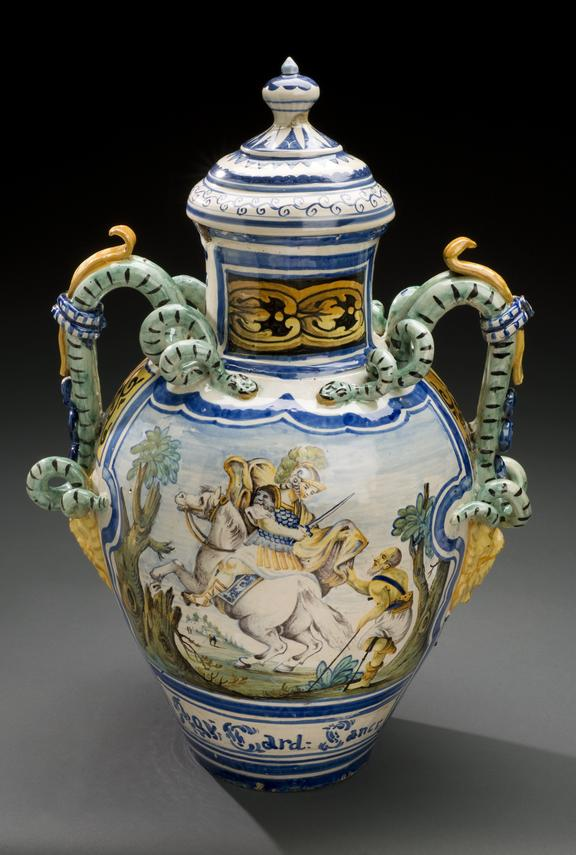 Earthen ware storage jar, polychrome, decorated with scene of St. Martin and beggar, for storing blessed thistle water,