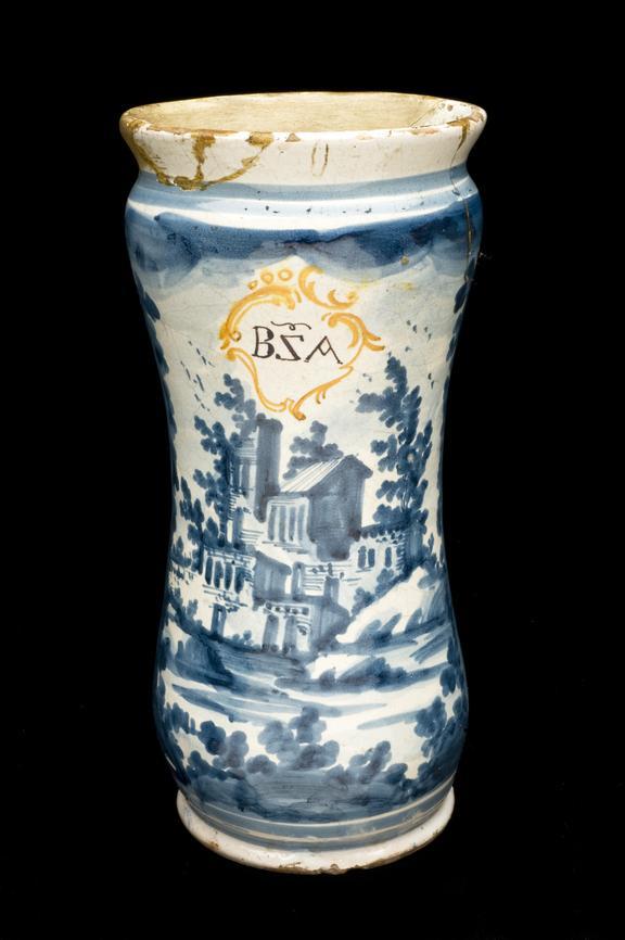 Albarello vase, Italian, 1710-1790, blue and white maiolica, scene of country villa. Black background.