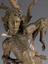 Statue of Saint Sebastian, oak, possible 16th century, German. Front detail view, grey background.
