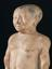 Plaster statue of the dwarf chnoum-hotep, a victim of achondroplasia, 2000 - 1000 BC. Front three quarter detail view.
