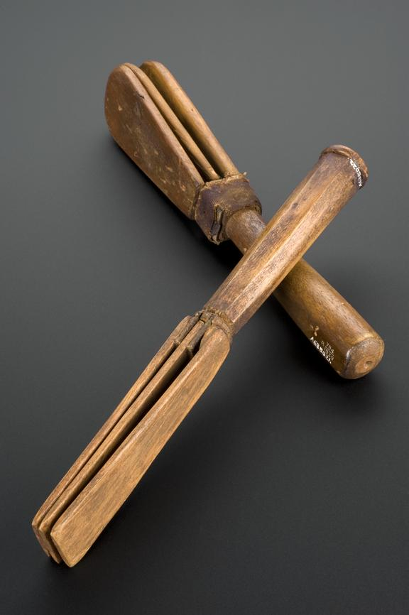 A635021, Wooden leper clapper, English, 17th century. A635022, Wooden leper clapper, English, 17th century. Matt black