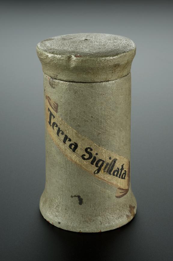 Turned wooden drug jar, used for bole, possibly Spanish, 1601-1700. Graduated black background.
