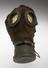 Gas mask, German. 1915-1918. Front view. Graduated grey background.