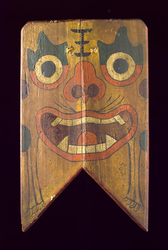 Large wooden shield painted with demon's face, hung outside house to keep away evil spirits, Chinense, 1801-1900. Front