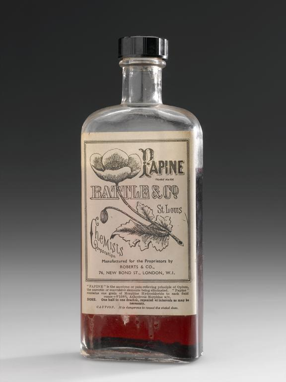 """Bottle of """"Papine"""", by Roberts and Co. for Battle and Co., St. Louis, U.S.A..  Whole object, grey background"""