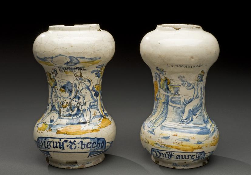 Left hand side - A633767, Dumbell albarello, majolica, with biblical scene, used for unknown drug, Italian, perhaps