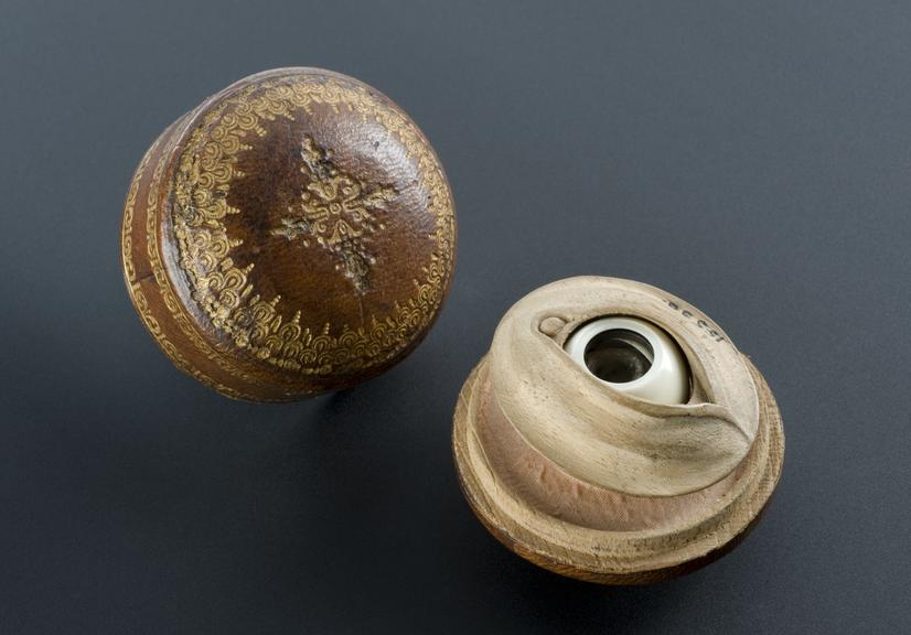 Ivory and horn artificial eye in leather covered box, Italian, possibly 17th century. Graduated black background.