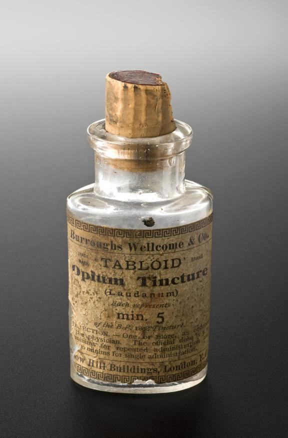 Bottle, clear glass, with stopper, empty, 'opium tinture' for laudanum tablets, by Burroughs Wellcome, English, second