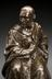 Bronze statuette of Joseph Lister. Detail view of head and shoulders. Graduated grey background.