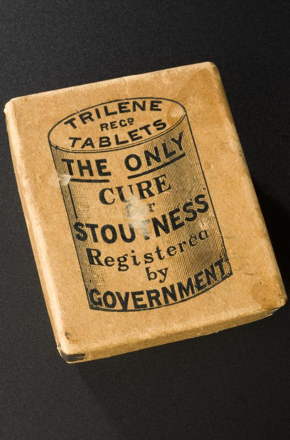 "Carton for ""Trilene"" tablets. Full view, graduated matt black perspex background."