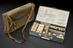 First aid kit in aluminium case in canvas satchel, used on U.S. Army air service world flight of 1924, by Burroughs,
