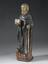Statue of Saint Anthony the Hermit, Dutch, 16th century. Front three quarter view. Graduated grey background.