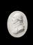 """Plaster cast of Dr Black, oval 3 3/4"""" x 2 7/8"""".  Overhead view of whole object against black background."""