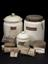 Group of objects from Watt Workshop. White ceramic jar with leather lid; labelled; Smyrna Lizari; (1924-792/1479); rear