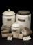 """Group of objects from Watt Workshop. White ceramic jar with leather lid, labelled   """"Smyrna Lizari""""  (1924-792/1479),"""