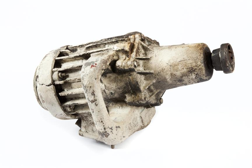 Electric drill motor, coal mining..Photographed 3/4 view on a white background.