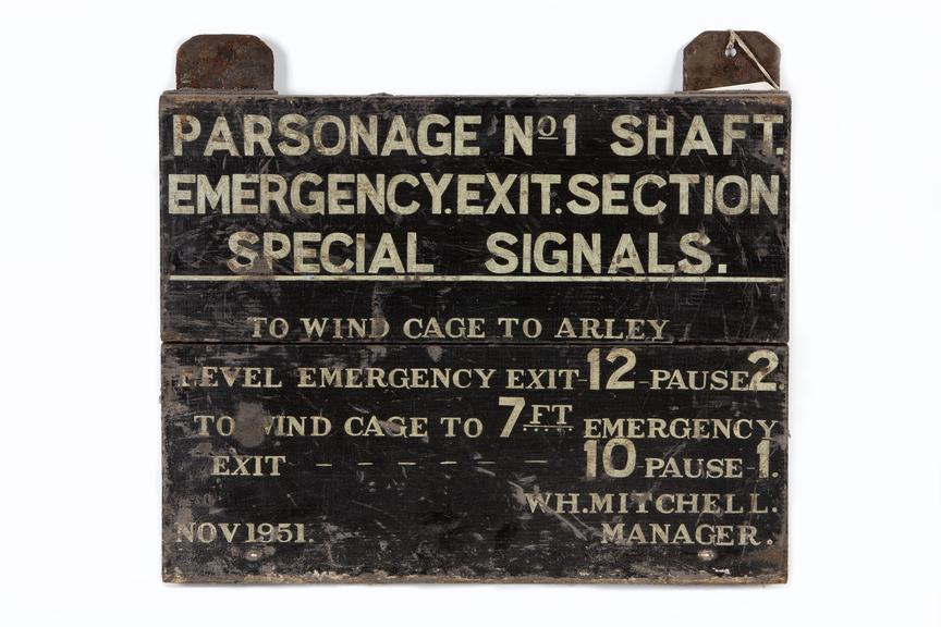 Sign: 'Parsonage No1 shaft...'Photographed straight on view on a white background.