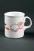 Mug; produced by the BBC to promote Radio Manchester; inscription reads 'BBC // Radio Manchester // YOUR SMILE ON THE