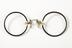 Black-shell rimmed pince-nez, c. 1924.Photographed on a white background.