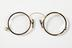 Shell-rimmed pince-nez.Photographed on a white background.