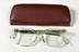 Pair of NHS spectacles in case, c. 1984.Photographed from above on a white background.