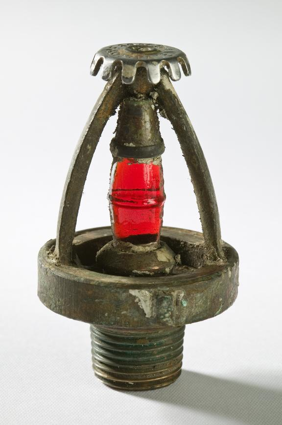 Mather and Platt fire pump system sprinkler head, photographed straight on view on a white background.The pump is a