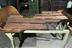 Oil spill damage on tobacco rolling bench:Tobacco spinning machine, made by P. Moorhouse, Stockport and used at the
