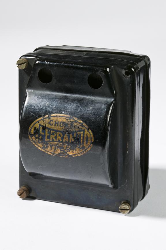 Ferranti Ltd model Choke B1 transformer.Photographed 3/4 view on a white background.