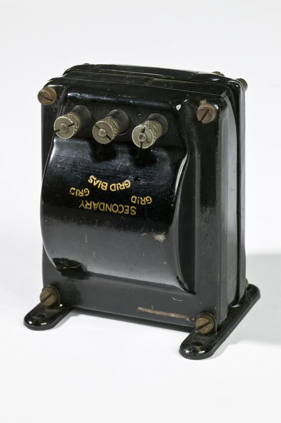Ferranti audiofrequency transformer.Photographed on a white background.