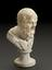 """Bust on pedestal, of Socrates, 7 1/2"""" high. Three quarter view, graduated grey to black background"""