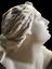 """Plaster bust, Niobe ? Piece broken off shoulder (repaired), height 14"""". Close up profile view. Black background"""