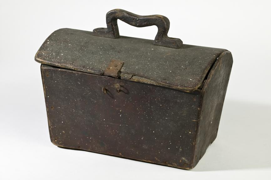 Wooden lunch box, c. 1900Photographed 3/4 view on a white background.