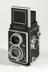 Twin lens reflex camera with case, 1960Photographed on a white background.