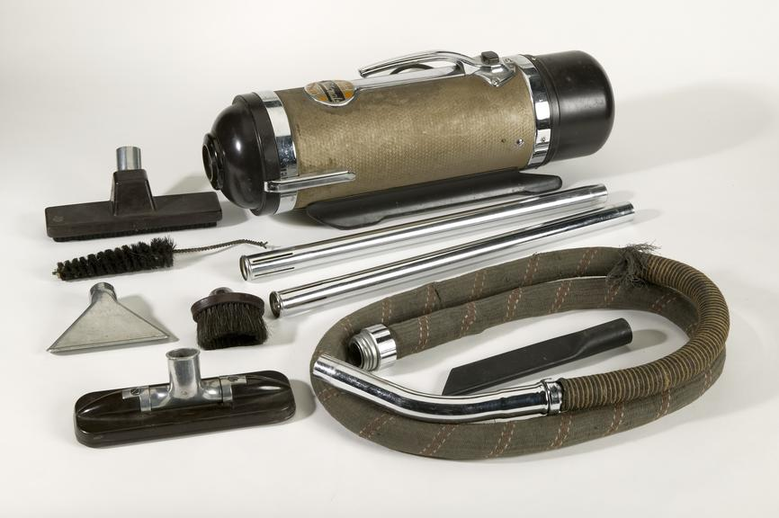 Vacuum cleaner, made by National Utilities Ltd, Manchester, c.1930-45; includes 3 brush attachments, 2 metal tubes, 1