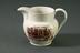 commemorative jug, 1835.Photographed on a grey background.